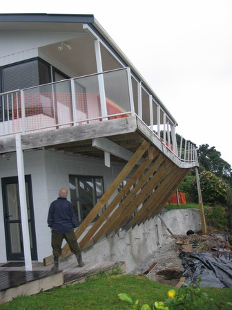 Day: Large slip beneath Paku home. EQC emergency temporary stabilisation work evident.